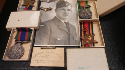 George Roy  Bullion , Pilot Officer, Service number: J/92177 attached to squad Royal Canadian Air Force.